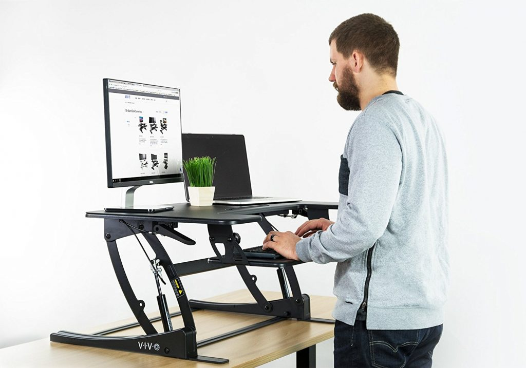 5 Easy Ways To Prevent Back Pain While Sitting At A Desk: Invest in a standing desk